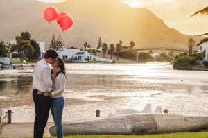"<a href=""http://www.freepik.com/free-photo/couple-kissing-in-a-park-with-red-balloons-at-sunset_1035175.htm"">Designed by Freepik</a>"